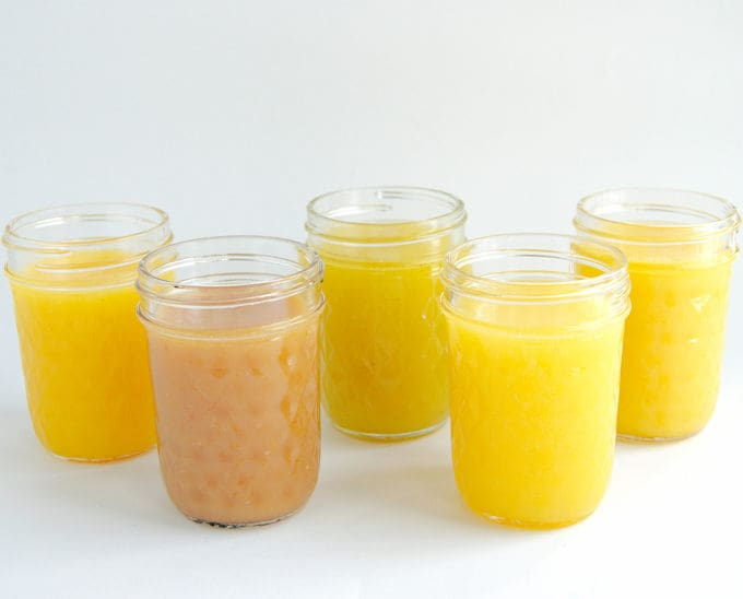 passion fruit curd, guava curd, pineapple curd and mango curd in jars