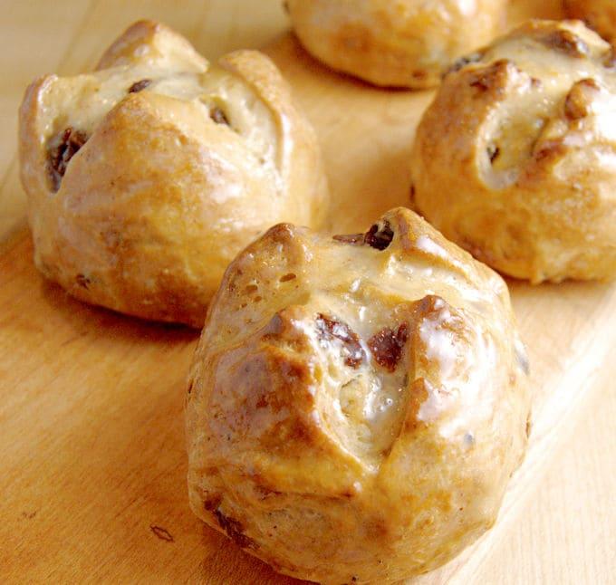 hot cross buns on a wood surface