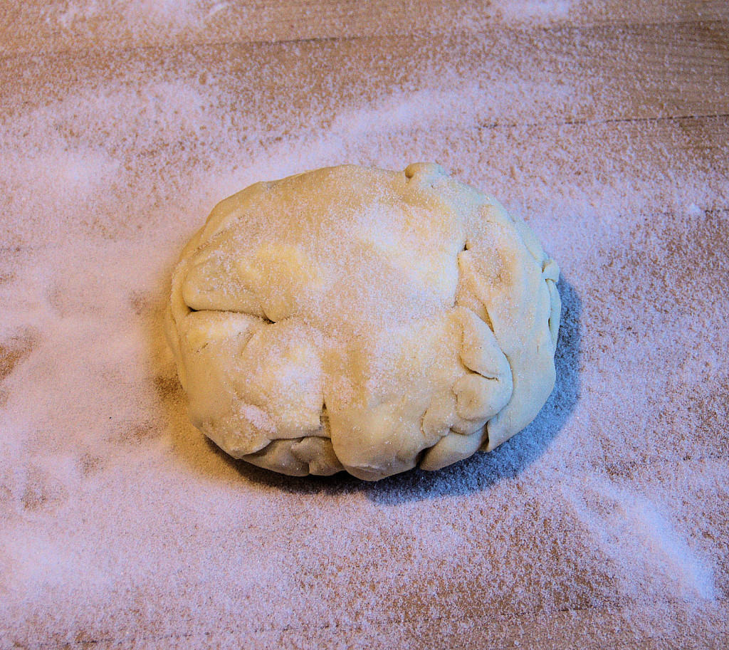 Gather the scraps from rolling the pie dough into a loose ball. The scraps can be  refrigerated or frozen to roll later.