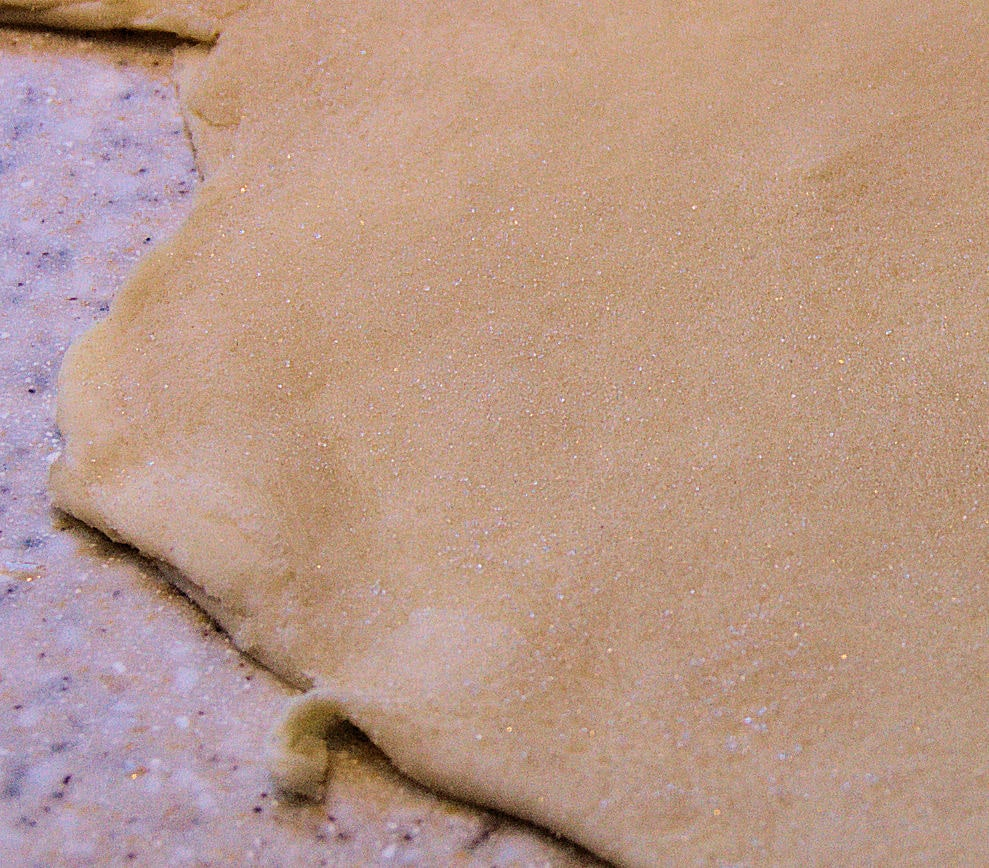 The sugar crystals are embedded in the dough.