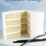 a 4 layer vanilla cake with vanilla icing on a white cake plate