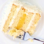 a slice of coconut cake with passion fruit curd
