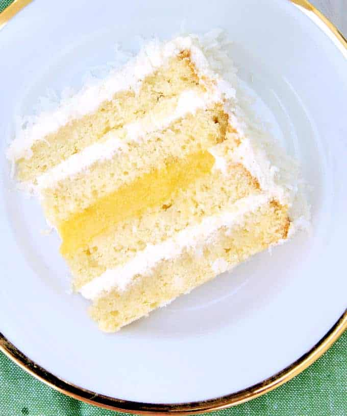 a slice of coconut passion fruit cake on a white plate