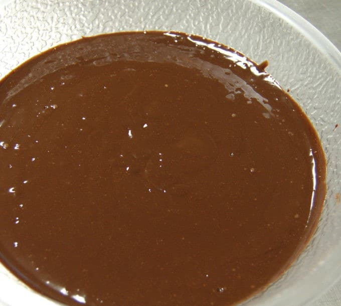 Allow the ganache to settle for a minute and then tap the bowl on the work surface to expel some of the bubbles.