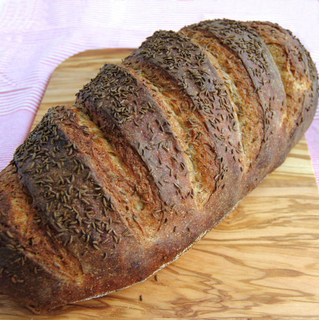 rye bread with caraway seeds on a cutting board