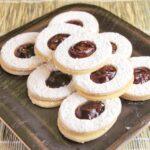 short dough sandwich cookies with raspberry jam