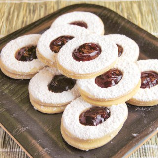 short dough sandwich cookies with raspberry jam