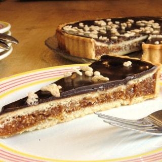 a slice of Chocolate Caramel Crackle Tart