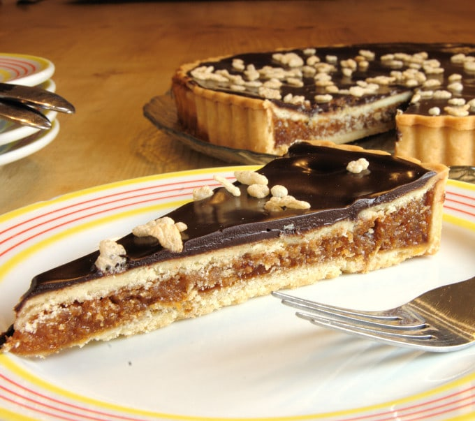 a slice of Chocolate Caramel Crackle Tart