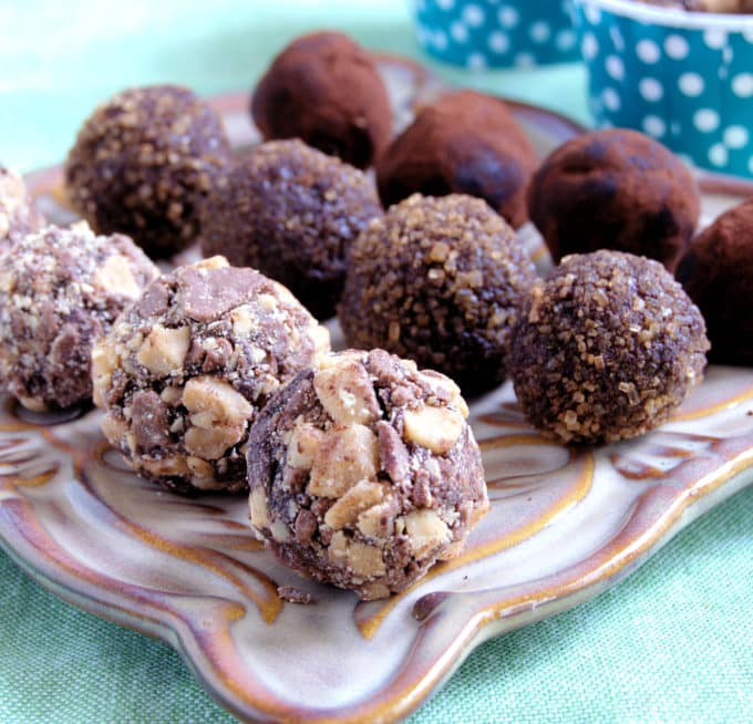 Chocolate Truffles finished with Crushed Heath Bars, Cinnamon Sugar, and Cocoa Powder.