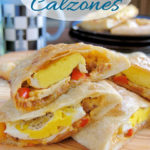 a pinterest image for breakfast calzones