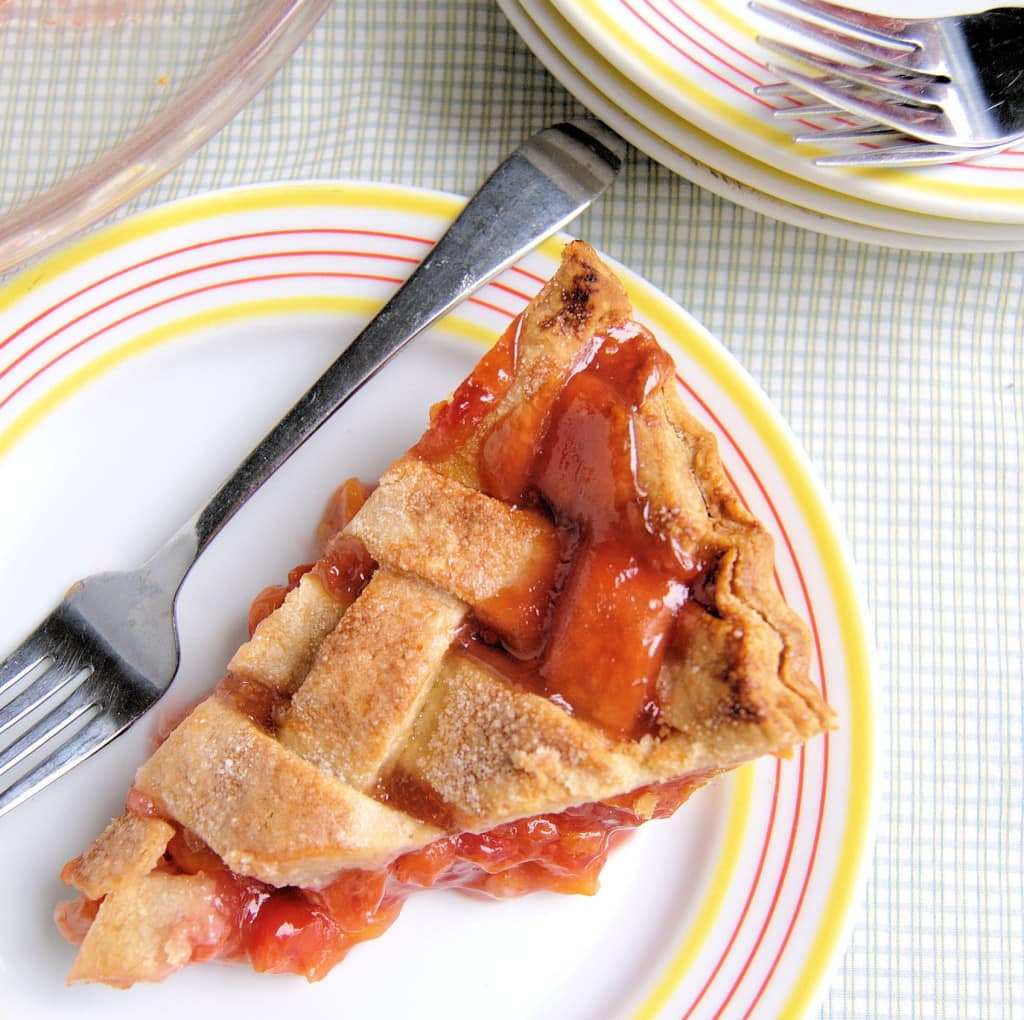 a slice of Sour Cherry Pie on a plate
