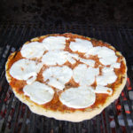 a pizza on a grill
