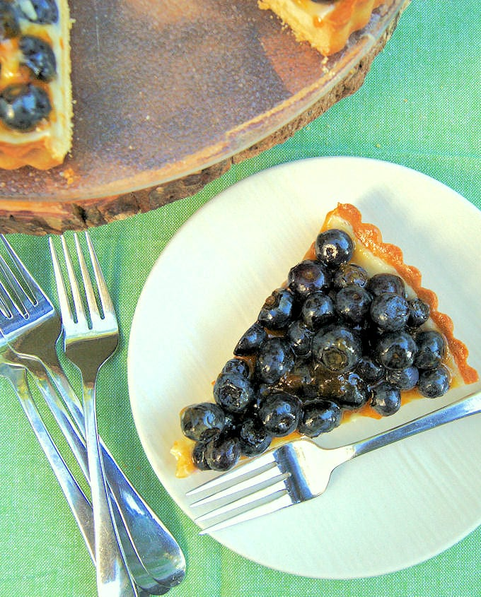 a slice of blueberry cheesecake tart on a plate