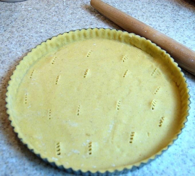 unbaked cornmeal crust in a tart pan