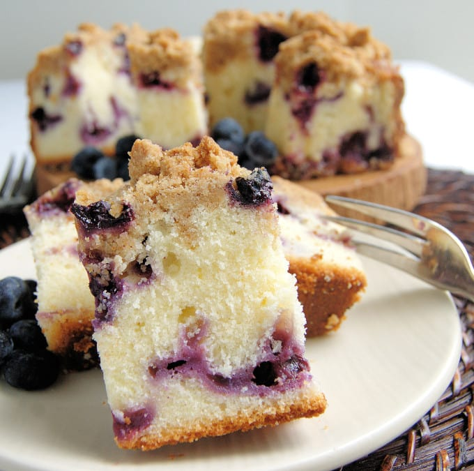 a slice of blueberry buttermilk coffee cake