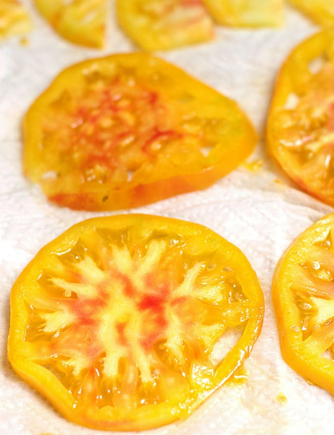 slices of heirloom tomatoes on a paper towel