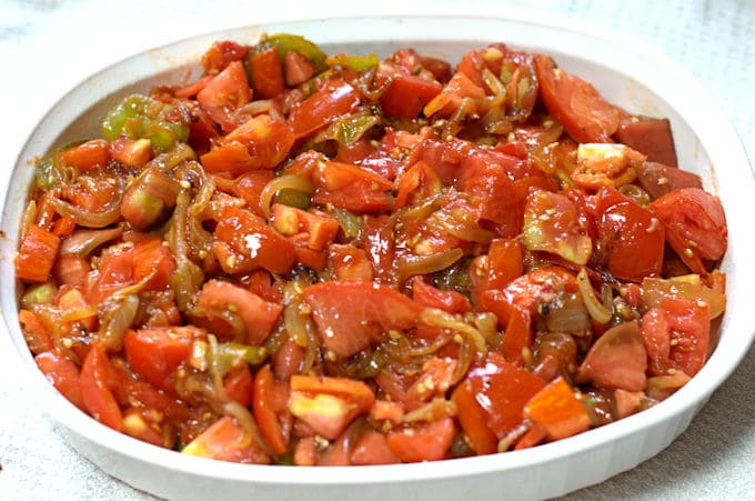 tomato cobbler filling in a casserole dish
