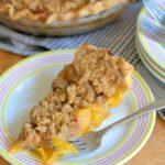 a slice of peach almond crumb pie