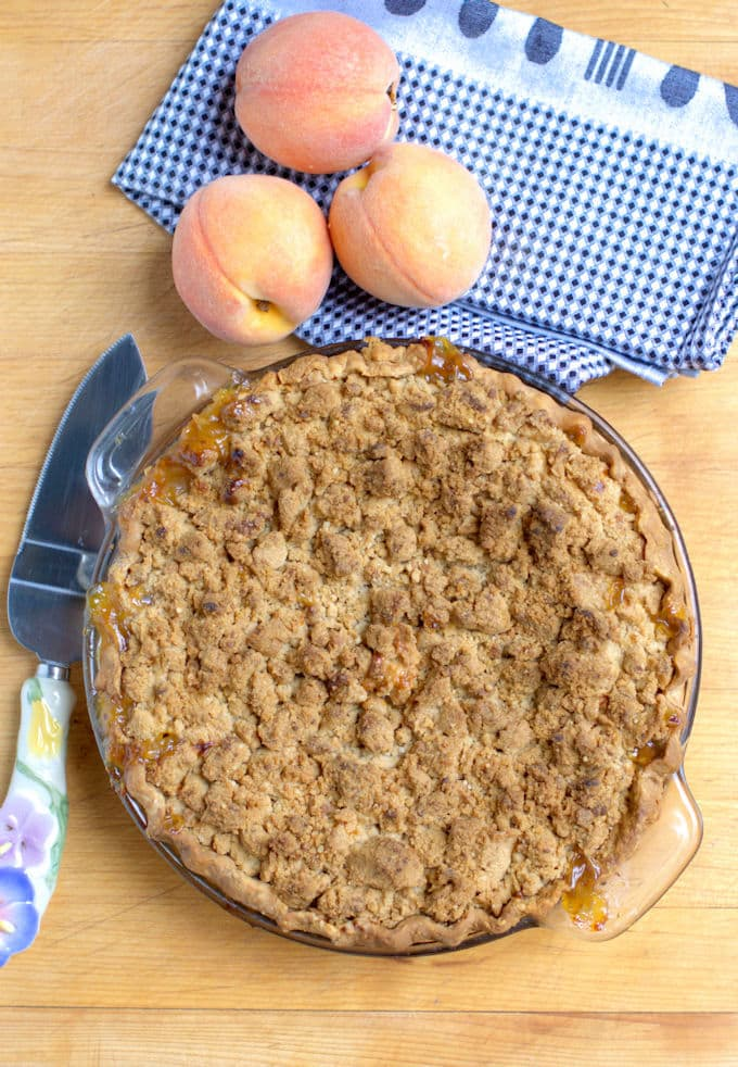 a peach crumb pie on a table