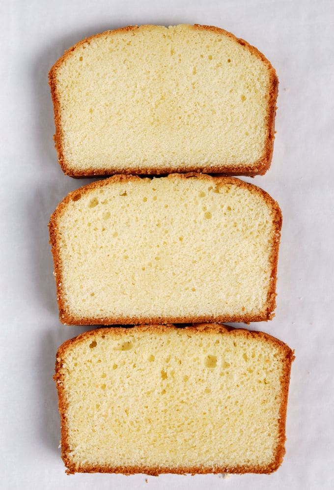 Three slices of pound cake arranged on a white background. Each cake has a different texture.