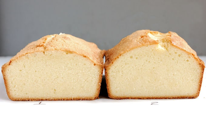 Two pound cakes on a white surface with a gray background