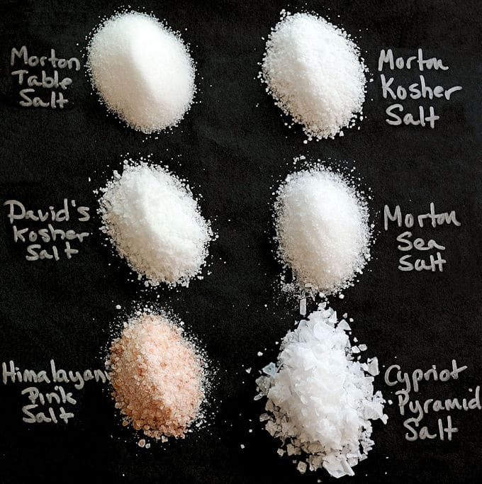 A photo showing the size and shape of various types of salt