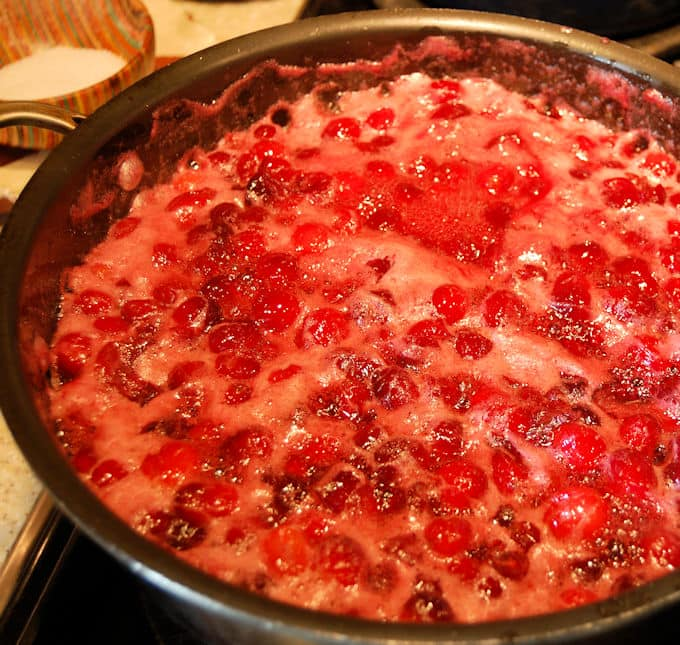 Once the cranberries start popping, simmer for 10 minutes. They'll foam up a bit.