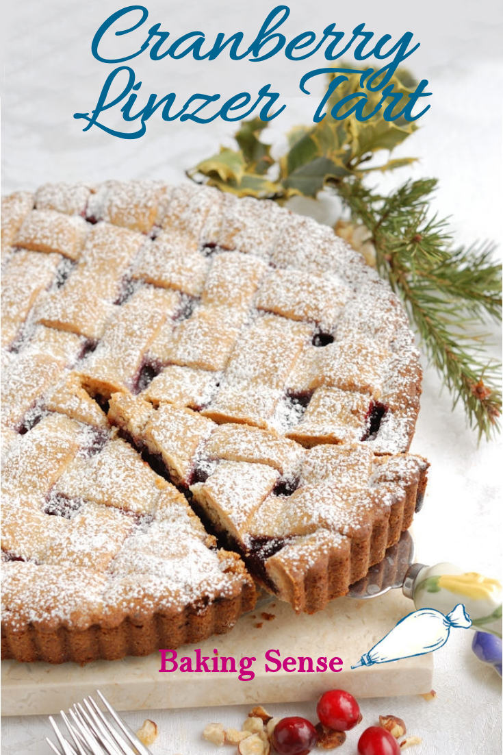 Cranberry Linzer Tart made with hazelnut dough and filled with homemade cranberries cooked in red wine. #linzer #hazelnut #cranberry #holiday #best #recipe