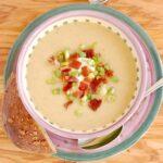 a bowl of celeriac leek potato soup