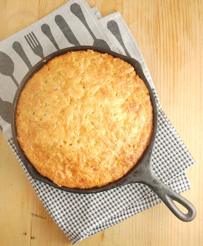 cast iron skillet mexican cornbread on a kitchen towel