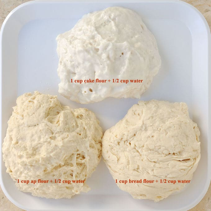 Three pieces of flour and water dough arranged on a white plate to show how in cake batter, flour is important.