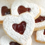 a closeup of heart shaped linzer cookies