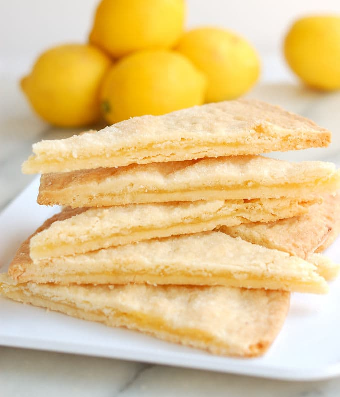 a stack of shortbread cookies filled lemon curd