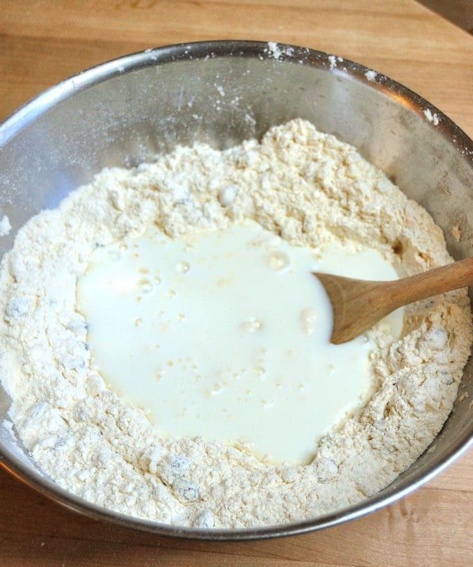 Pour buttermilk into flour to make irish soda bread