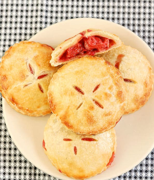 a plate of hand pies filled with roasted strawberries