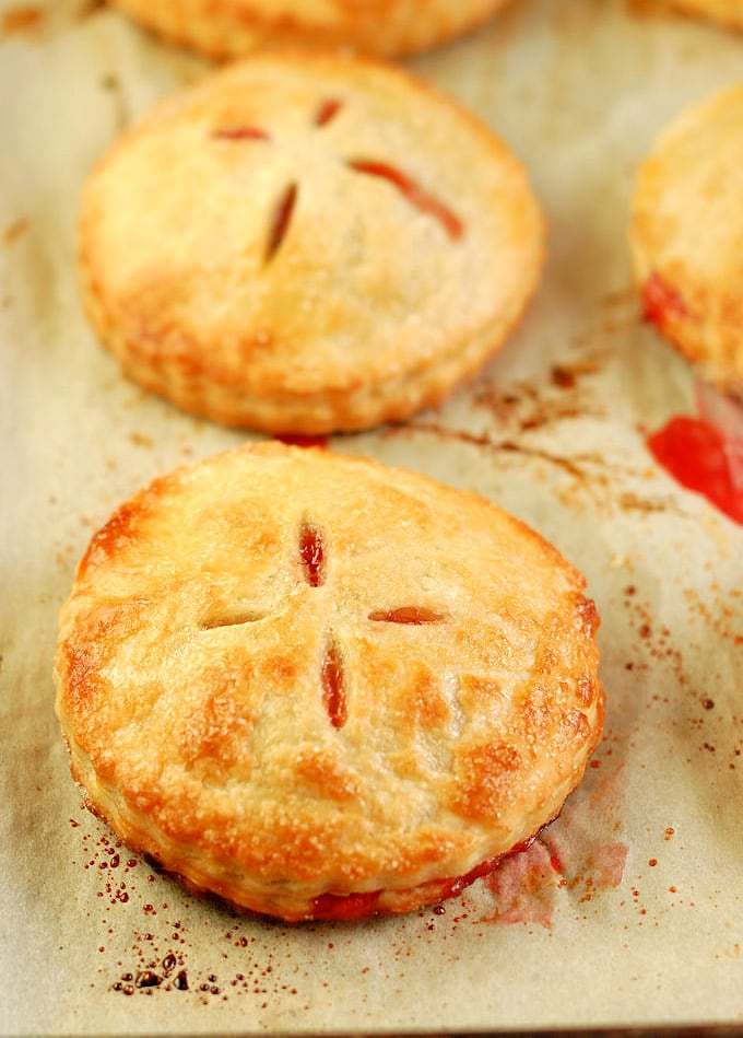 freshly baked strawberry hand pies on a tray