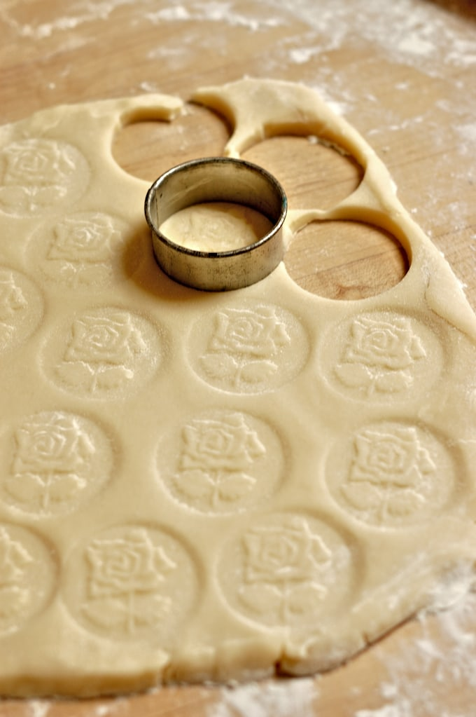cutting rounds of rosewater cookies