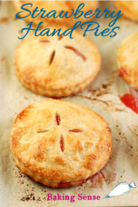 a tray of strawberry hand pies with text overlay for pinterest