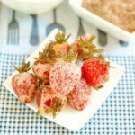 a plate of tempura strawberries