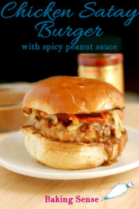 a pinterest image for chicken satay burger
