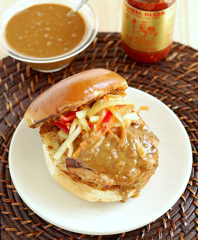 chicken satay burger with peanut sauce on a plate