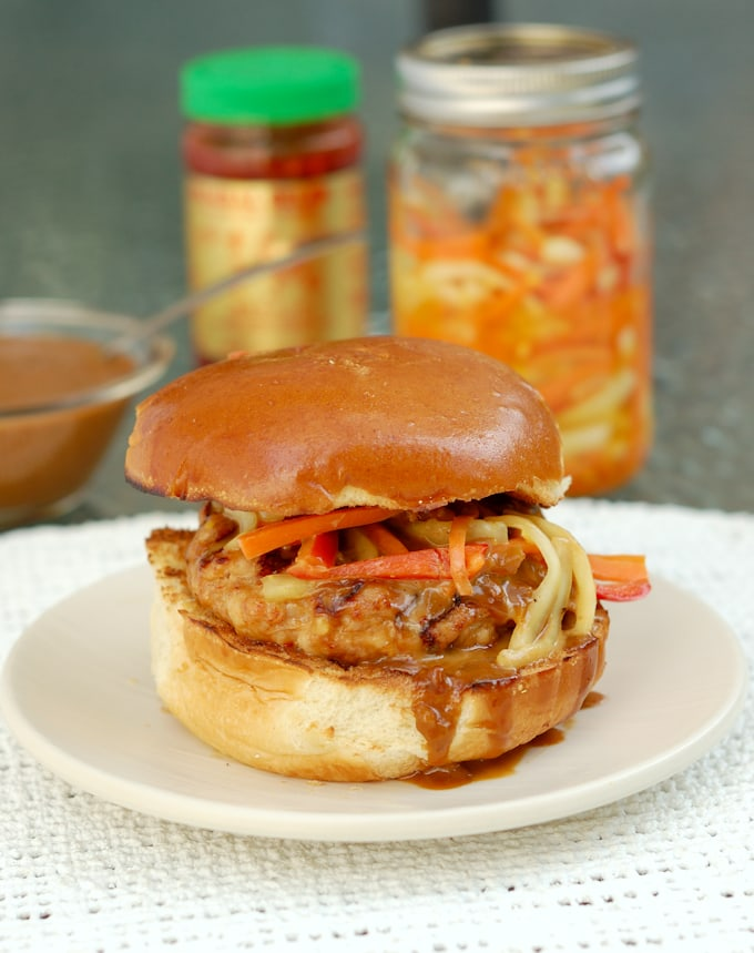 chicken satay burger with peanut sauce on a bun