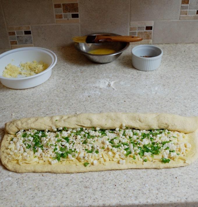 rolling the filling into sourdough cornbread