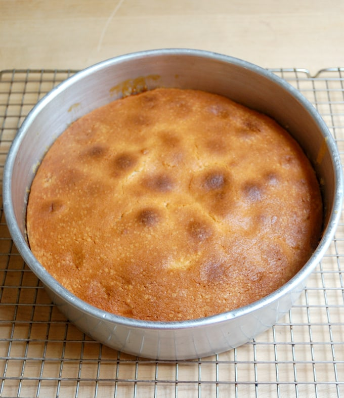 a baked peach cake in a pan.