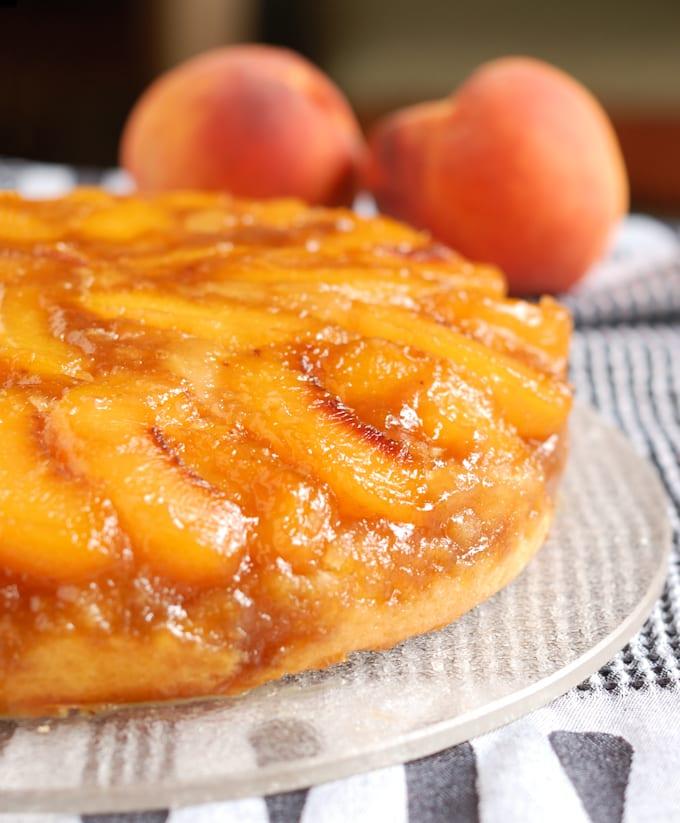 a closeup of a peach upside down cake