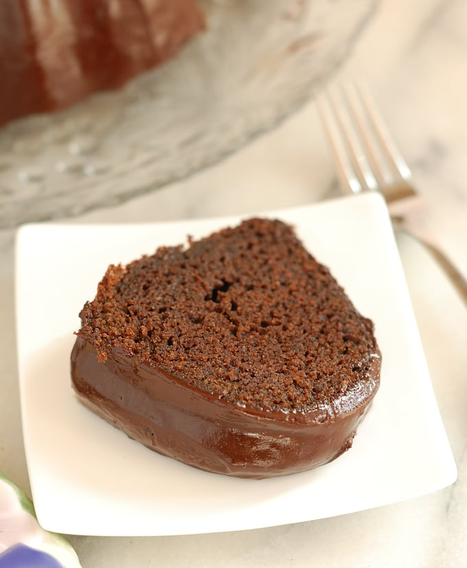 a slice of chocolate beet cake on a white plate