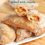 a pinterest image for fried peach hand pies with text overlay