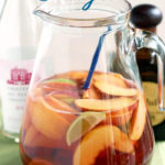 a pinterest image of a pitcher of sangria with text overlay
