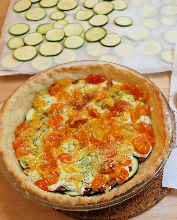 layering ingredients for zucchini pie